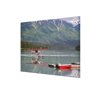 Float plane and boat, Trail Lake, Alaska, USA Canvas Print