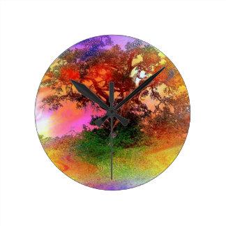 Floating black tree on rainbow foggy background round clock
