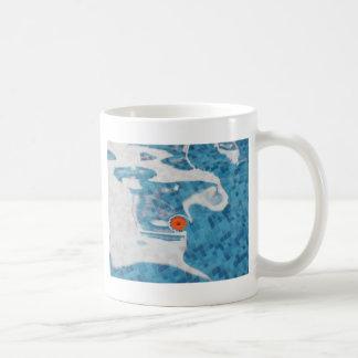 Floating Orange Spring  Flower in Blue Water Mugs
