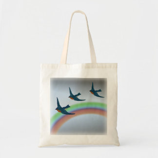 Flock of Bluebirds Flying Over a Rainbow Tote Bag