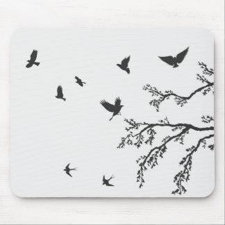 flock of flying birds on tree branch mouse pad
