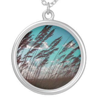 Florida seaoats against teal sky dune backdrop silver plated necklace