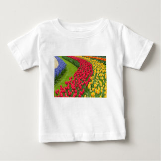 Flower beds of multicolored tulips baby T-Shirt