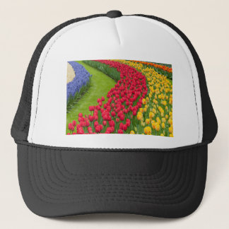 Flower beds of multicolored tulips trucker hat
