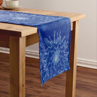 flower on blue short table runner