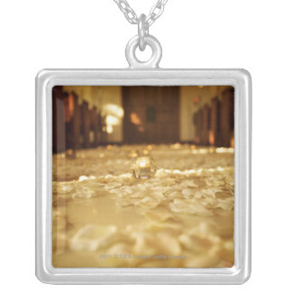 Flower petals on floor of church silver plated necklace
