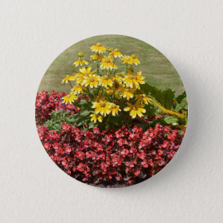 Flowerbed of coneflowers and begonias 6 cm round badge