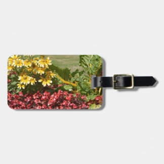 Flowerbed of coneflowers and begonias luggage tag