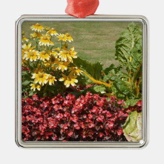 Flowerbed of coneflowers and begonias metal ornament
