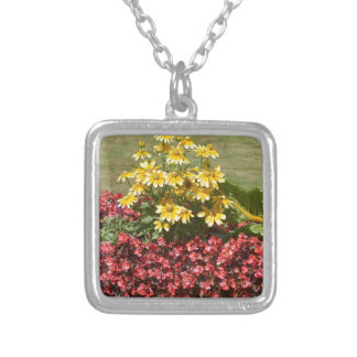 Flowerbed of coneflowers and begonias silver plated necklace