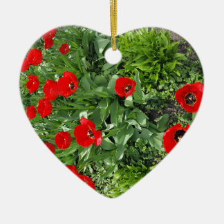 Flowerbed with red tulips ceramic heart decoration