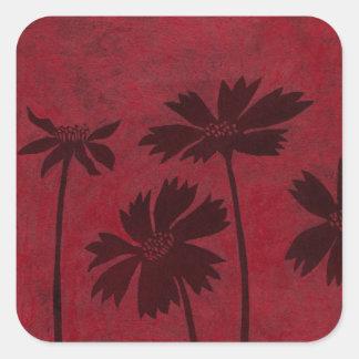 Flowerhead Silhouettes on Crimson Background Square Sticker