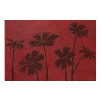 Flowerhead Silhouettes on Crimson Background Wood Print