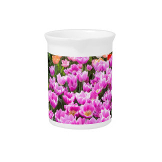 Flowers field with different colored tulips beverage pitchers