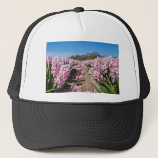 Flowers field with pink hyacinths in Holland Trucker Hat