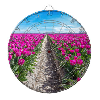 Flowers field with purple tulips and path dart board