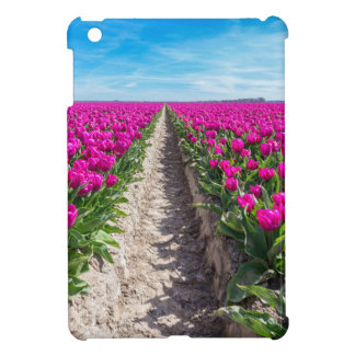 Flowers field with purple tulips and path iPad mini case