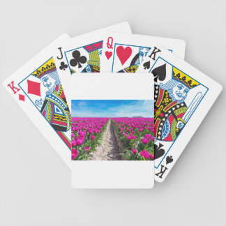 Flowers field with purple tulips and path poker deck