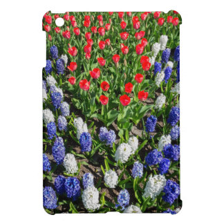 Flowers field with red blue tulips and hyacinths iPad mini covers