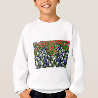 Flowers field with red blue tulips and hyacinths sweatshirt