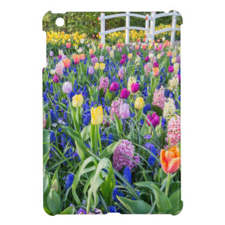 Flowers field with tulips hyacinths and bridge iPad mini cases