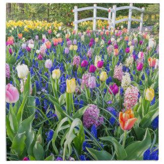 Flowers field with tulips hyacinths and bridge napkin