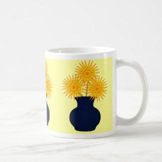 Flowers in a blue vase mug