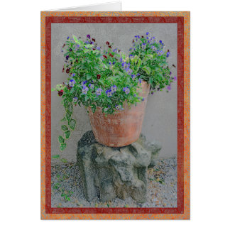 Flowers in a terra-cotta pot on rock card