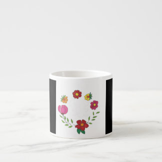 flowers in black n white espresso cup