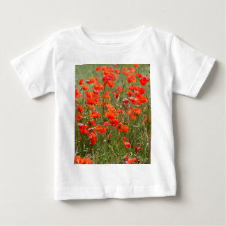 Flowers of common poppy in a field. baby T-Shirt