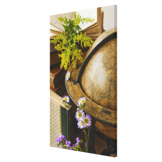 Flowers with antique globe and books gallery wrapped canvas
