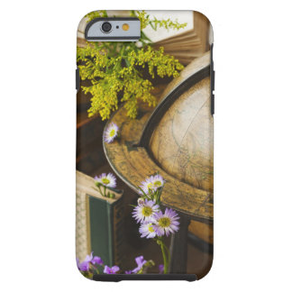 Flowers with antique globe and books tough iPhone 6 case