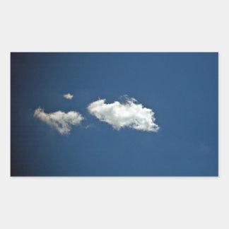 Fluffy white cloud on deep blue sky rectangular sticker
