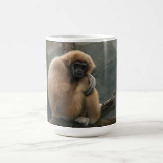 Fluffy white-handed lar gibbon coffee mug