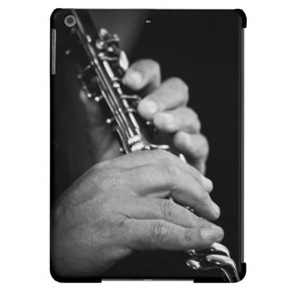 Flute being played in black and white by gypsy case for iPad air