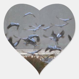 Flying cranes heart sticker