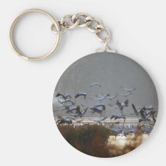 Flying cranes key ring