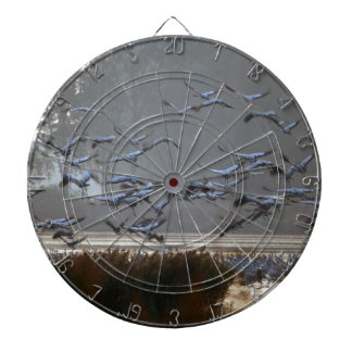 Flying cranes on a lake dartboard