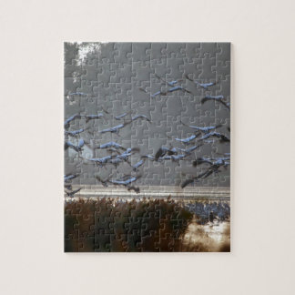 Flying cranes on a lake jigsaw puzzle