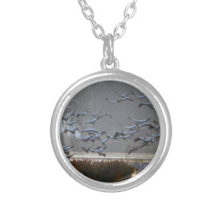 Flying cranes on a lake silver plated necklace