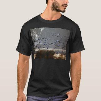 Flying cranes on a lake T-Shirt