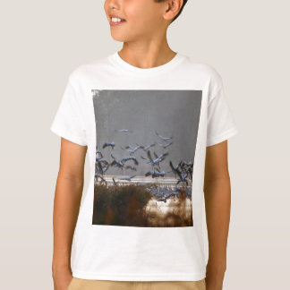 Flying cranes on a lake T-Shirt