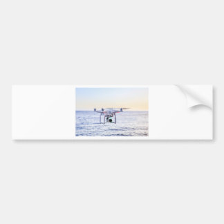 Flying drone at coast above sea bumper sticker