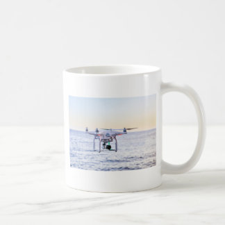 Flying drone at coast above sea coffee mug
