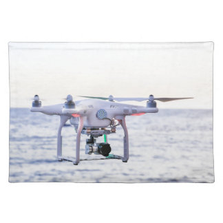 Flying drone at coast above sea placemat