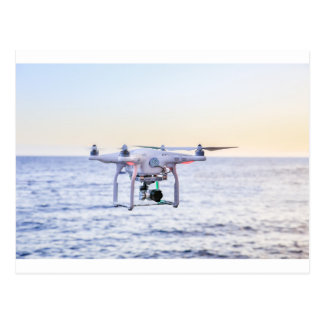 Flying drone at coast above sea postcard