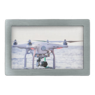 Flying drone at coast above sea rectangular belt buckle