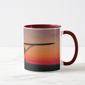 Flying into the sunset mug