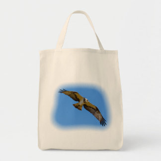 Flying osprey with a target in sight tote bag