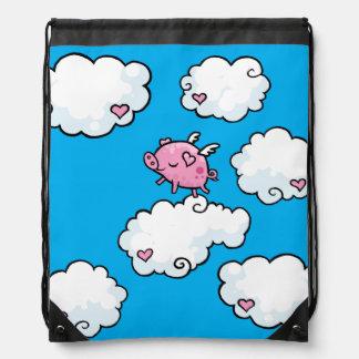 Flying pig dances on clouds drawstring bag